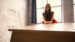 Attractive young woman leaned on a white grand piano Stock Footage