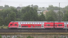 4K Pan left regional train pass residential area in famous Dresden passenger day Stock Footage