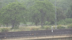 4K Aerial view heavy rain fall on countryside rails infrastructure bad weather Stock Footage