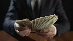 Corrupt official counting bundle of money, taking bribe for abuse of power Stock Footage