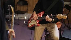 Hands of Two Men Playing Electric Guitars Stock Footage