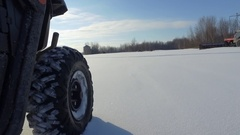Utv tires closeup driving in winter spinning up powder snow 4k Arkistovideo
