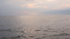 Beautiful calm ocean waters near sunset Stock Footage