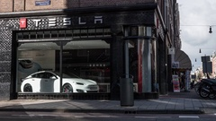Timelapse of people and traffic in street with Tesla Store Stock Footage