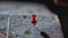 Close up of French city map, hand of tourist marking trip destination with pin Stock Footage