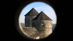 Two towers of Kamianets-Podilskyi castle, old stone fortress in western Ukraine Stock Footage
