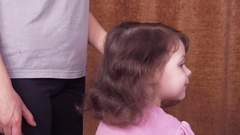 Mother braiding daughter. Stock Footage
