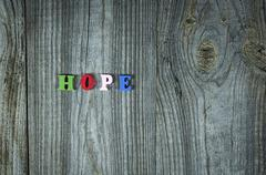 Words of hope from small multi-colored wooden letters Stock Photos