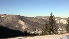 Panoramic shot of winter mountains at sunny day Stock Footage
