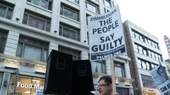 """THE PEOPLE SAY GUILTY"" Sign Stock Footage"