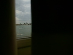 Man drawing the curtains of his window and seeing Italian city, Venice Stock Footage