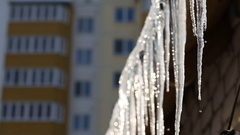 Icicles hanging from roof begin to melt with the coming of spring. Stock Footage