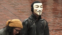 We The People Speech With Anonymous On The Move Stock Footage