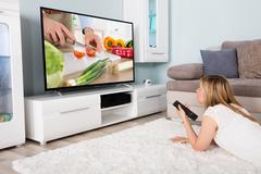 Woman Watching Cooking Show On Television Kuvituskuvat