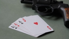 Loaded revolver-weighty argument when winning at cards Stock Footage