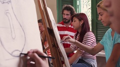 Art School With Teacher And Students Painting In Class Stock Footage