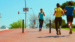 Woman having muscle cramp while running, steadycam shot, slow motion shot  Stock Footage