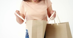 Smiling woman looking in shopping bag Stock Footage