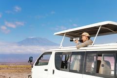 Photographer taking shots of Kilimanjaro mount Kuvituskuvat