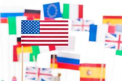 American flag against flags of EU member states Stock Photos