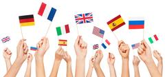 Hands holding flags of USA and EU member-states Stock Photos