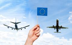 Man's hand holding European Union flag with pole Kuvituskuvat