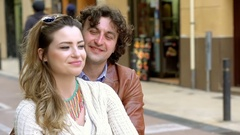 Couple cuddling and smiling, in the city, steadycam shot, slow motion shot Stock Footage