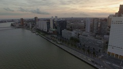 Aerial view of cityscape with modern buildings on the river against cloudy sky Stock Footage
