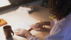 Diligent female student studying books till late at library, preparing for exam Stock Footage