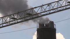 Heavy industry construction smokestacks and carbon emissions Stock Footage