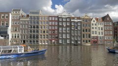 Timelapse of touristic water buses on Amsterdam canal Stock Footage