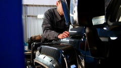 Mechanic looking to hood of the car - automobile service Stock Footage