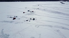 Aerial ice fishing recreation mountain lake winter 4K Stock Footage