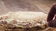 Slow motion of man hand rolling blini or crepes Stock Footage