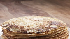 Slow motion of yogurt pour on freshly made blinis or crepes Stock Footage