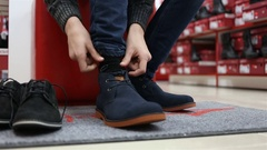 Hands Of child Tied The Shoelace in shop Stock Footage