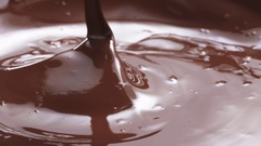 Slow motion of pouring melted premium dark chocolate Stock Footage