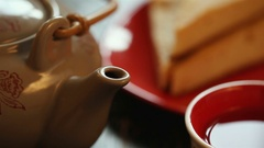 Black tea and cake. Morning composition on the table for the background Stock Footage