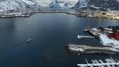 Drone shot of a boat in Lofoten, Norway, wide Stock Footage