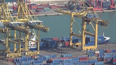 4K Aerial view Barcelona industrial port busy container platform cargo ship bay Stock Footage