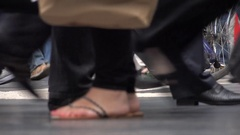 4K Crowded platform of tourist people pass commuter leg motion foot movement day Stock Footage