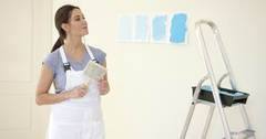 Attractive capable woman redecorating her home Stock Footage