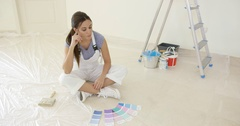 Young woman renovating or decorating her new home Stock Footage