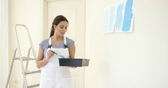 Young woman decorating her home Stock Footage