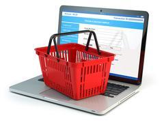 Online shopping e-commerce concept. Shopping basket on laptop keyboard isol.. Piirros