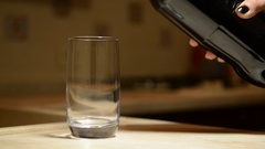 Close up shot of a highball glass in which a cola soda pop drink is poured. Stock Footage