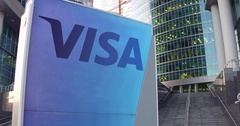 Street signage board with Visa Inc. logo. Modern office center skyscraper and Stock Footage