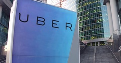 Street signage board with Uber Technologies Inc. logo. Modern office center Stock Footage