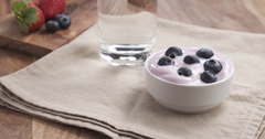 POV teen girl eating yogurt with blueberries Stock Footage