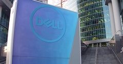 Street signage board with Dell Inc. logo. Modern office center skyscraper and Stock Footage